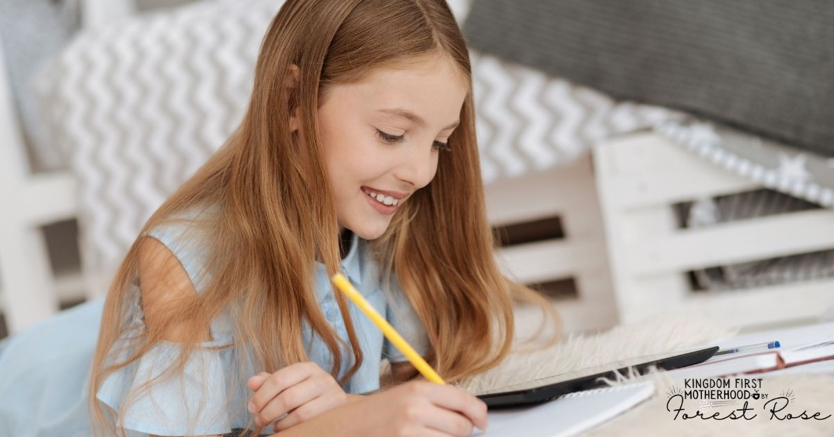 Girl working on spelling - Post on how to teach homeschool spelling